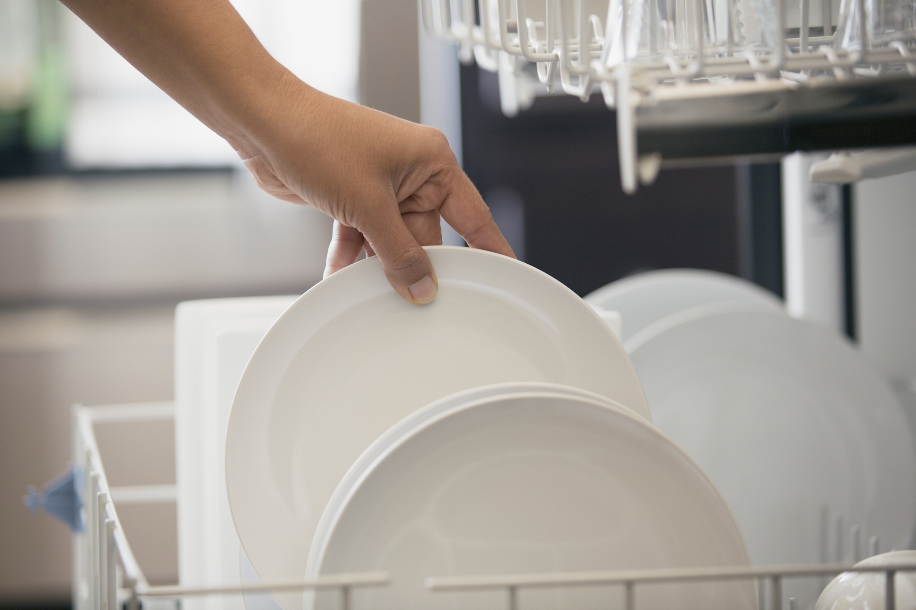 White dishes in Dishwashing machine