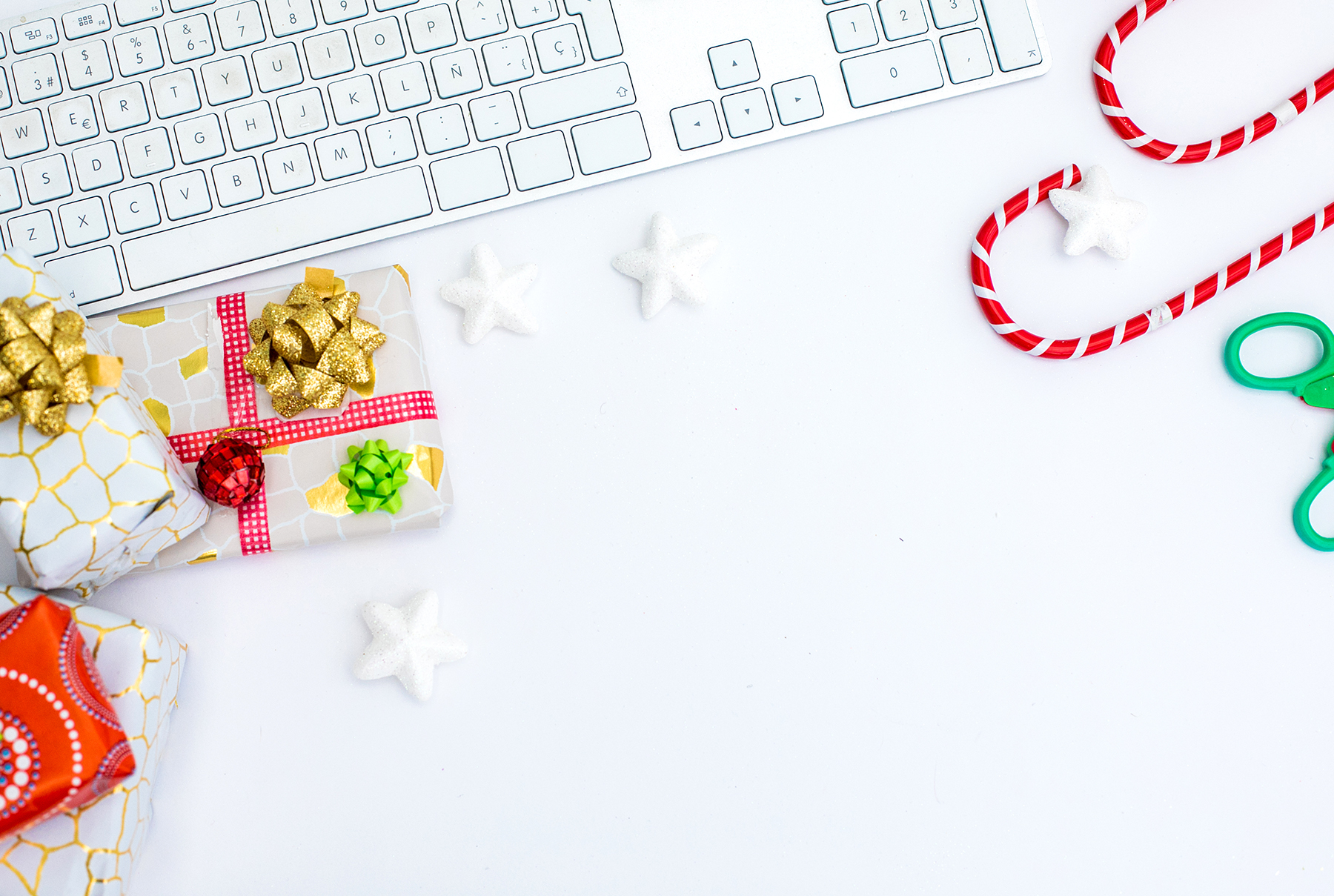 Office computer keyboard with holiday decorations and gifts