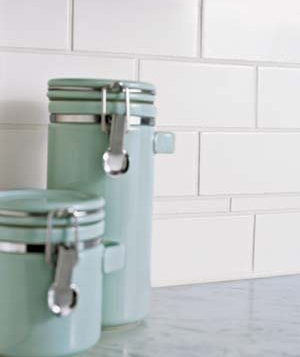 Canisters against a tile backsplash