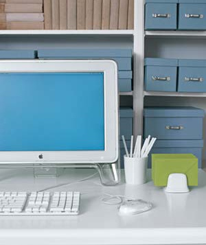 Small details―matching storage boxes, neutral tones―bring a calm sense of order to a home work area.