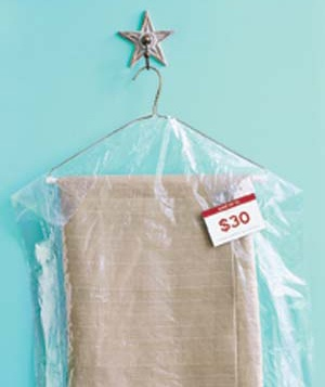 Dry cleaned garment with coupon