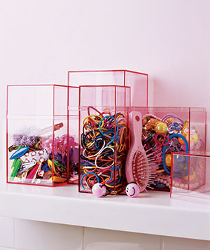 Girls' hair accessories stored in pink boxes