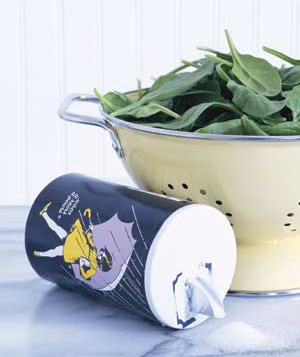 Morton salt and a bowl of spinach