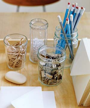 Old jam jars get new life as practical (and inexpensive) desk organizers.