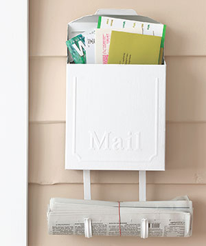 White mailbox filled with mail