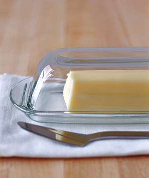Dish of butter with butter knife