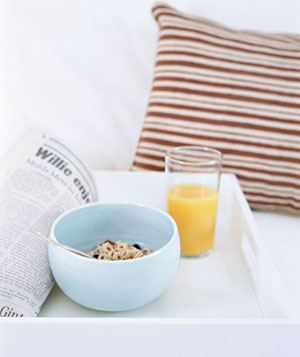 Painted plastic tray carrying breakfast