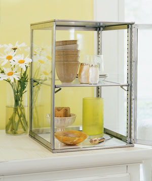Contain Collectibles in a Glass Pie Cabinet
