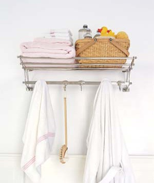 A shelf rack with hooks is an ingenious answer to the storage problem posed by smaller spaces.