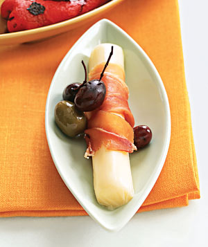 Olives and string cheese wrapped in prosciutto