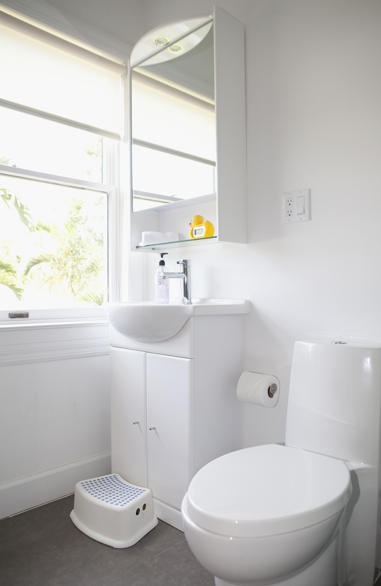 White bathroom sink and medicine cabinet