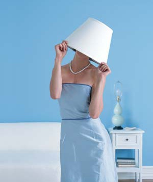 A woman with a lampshade over her head