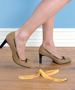 Woman walking near banana peel