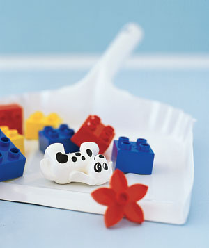 Toys gathered in a dustpan
