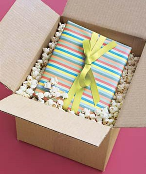Box packed with popcorn and gift