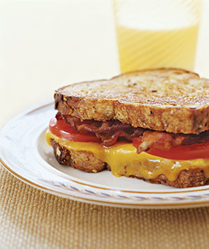Grilled cheese with bacon and tomoato sandwich