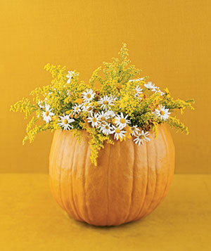 Flower centerpiece in pumpkin vase