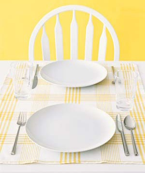 Yellow dish towels as placemats