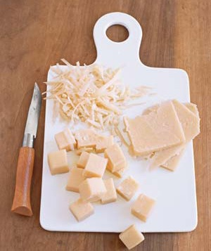 Cheddar cheese on cutting board