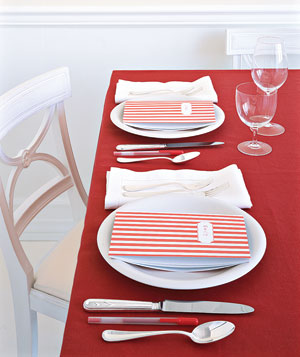 Striped notebooks on table settings