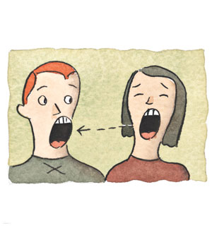 Two people yawning