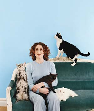 Woman sitting with cats