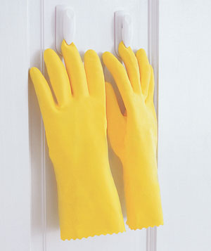 Rubber gloves hanging upside down from clips