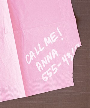 Phone number on a torn cocktail napkin
