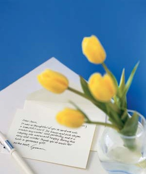 """Thank you"" note and yellow tulips"