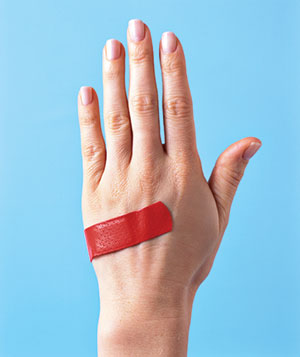 Red band aid on a hand