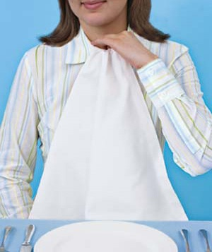 Woman with a napkin tucked into the top of her shirt