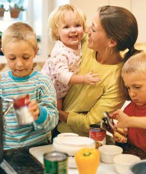 Mother and children in a kitchen