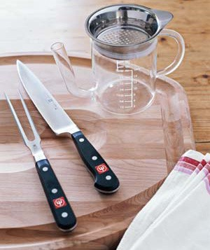 Carving knife set, carving board, and gravy separator