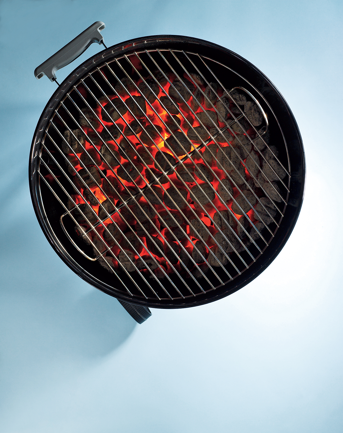 Round barbecue grill with burning embers