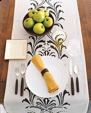 A pretty table runner laid down the length of a table can serve as both decoration and place mats. & Beautiful Table Settings | Real Simple