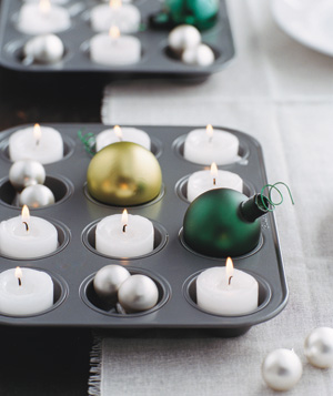 Candles and ornaments in muffin tin