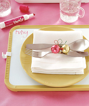 A whiteboard makes a clever charger-slash–place card―not to mention the perfect receptacle for dinnertime doodling.