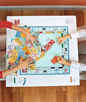 Siblings playing a board game