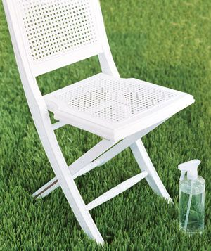 A chair and spray bottle on grass