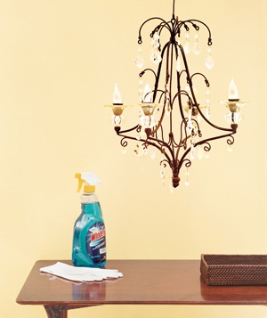 Chandelier and bottle of glass cleaner