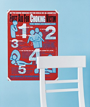 Choking first aid poster and a chair