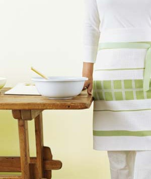 Woman wearing a dish towel apron near a mixing bowl