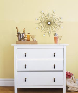 White dresser with brass knobs