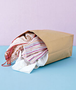 A paper bag filled with clothes