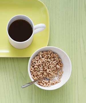 bowl of cereal and cup or coffee