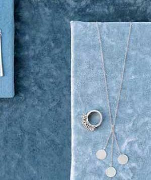 silver necklace and ring