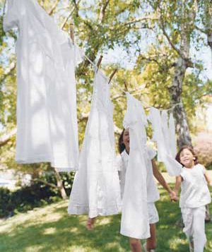 Children playing outside near clothesline