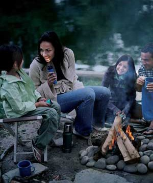 Family seated around campfire