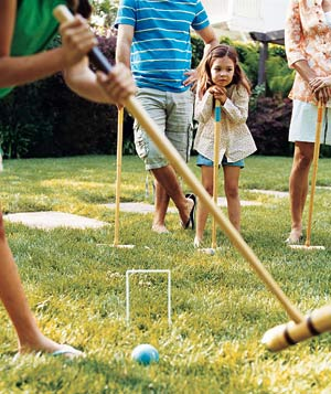Little girl playing croquet