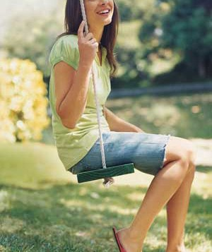 Woman sitting on swing